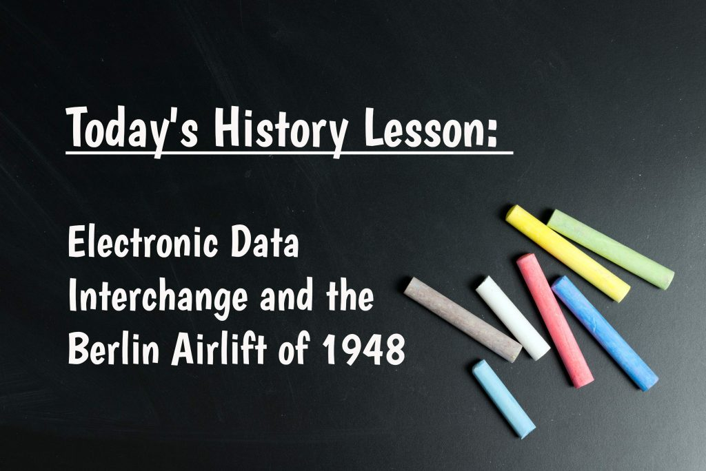 """Colorful chalk on chalkboard with text: """"Today's History Lesson: Electronic Data Interchange and the Berlin Airlift of 1948"""""""